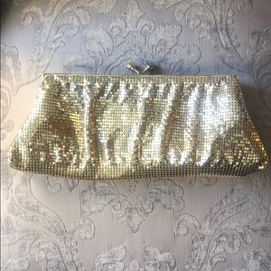 Shimmering metallic mesh light gold metal clutch.